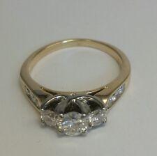 Three Stone Diamond Ring in 14 K Yellow and White Gold