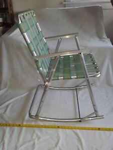 VINTAGE ROCKING Aluminum Lawn Chair, FOLDING, Webbed, Aluminum Arms.