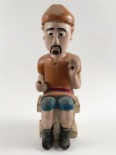 Hand carved wooden African figurine painted seated male figure