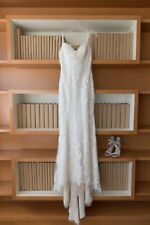 wedding dress. Ivory Lace over nude spaghetti strap.
