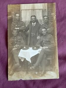 VINTAGE WW 1 ERA REAL PHOTO POSTCARD, GROUP OF YOUNG SOLDIERS IN A BACK YARD