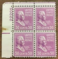 4 block of rose colored 50¢ President Taft postage stamps.  MNH