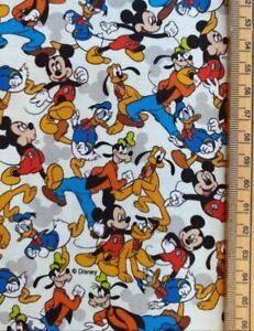 Mickey Mouse fabric UK 100% cotton material Walt Disney Pluto Goofy Donald