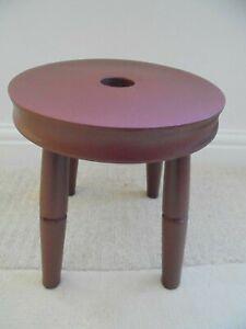 Vintage 4 legged round stool, painted red, maroon, chunky rustic, grab hole