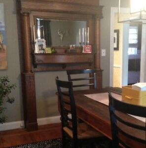 Antique Tiger Oak Mantle Surround with columns and beveled mirror