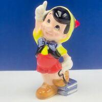 Pinocchio figurine vintage walt disney porcelain statue mcm vtg sculpture books