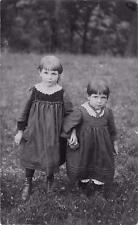 2 young girls sisters in field  qq53