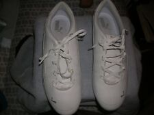 size 9.5 Womens    white and silver  Puma Brand