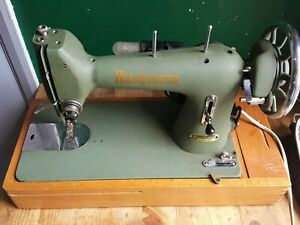 Husqvarna Model 12 Heavy Duty Sewing Machine with attachments