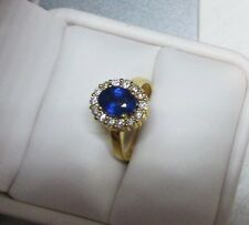 14K Ring with Cornflower Blue Sapphire and Halo of Diamonds  Q95