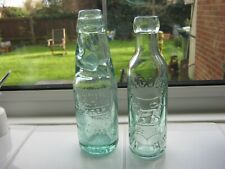 Two antique glass bottles; Laycock plus Codd bottle. Good condition