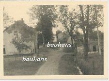 Foto 169.Inf.Division-Fahrt durch Belgien-zerschossenes Dorf 1940 (p104)