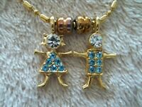 """Signed """"K.I.S.  USA"""" Necklace/Pendant, Gold Tone Metal, Boy & Girl Charms"""