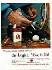 1964 L&M Cigarettes Man tying golfing shoe Vintage Print Ad