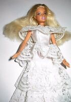Barbie doll golden blonde hair White Lace dress and green high heels
