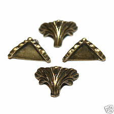 Pack of 4 very small bronze tone metal box corners with feet