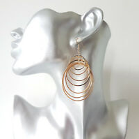 Gorgeous 7cm long gold tone graduated metal multi hoop drop earrings