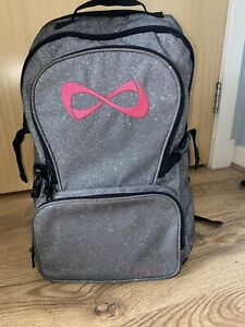 Nfinity Silver Sparkle Backpack with Pink Logo Cheerleading/Gymnastics Bag