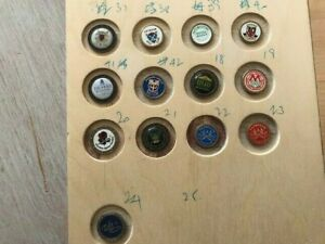 Collection of 24 golf ball markers