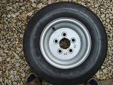 TRAILER WHEEL AND TYRE 5 X 100  20.5 X 8 X 10 TYRE. NEW UNUSED
