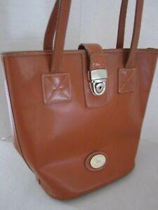 Vintage 90s Dooney Bourke Brown Leather Bucket Purse Bag. Silver Buckle Boho