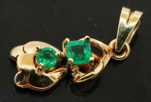 18K gold beautiful .50CTW emerald abstract pendant