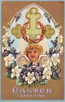 Easter Greetings 1909 Embossed Postcard Window Cross Flowers Angel