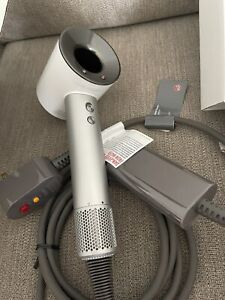 Dyson Supersonic Hair Dryer - White/Silver Brand New!  450$ Replacement Box