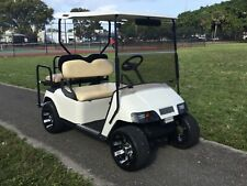 white ezgo GAS txt 4 seat Passenger golf cart custom rims lights flip seat lites