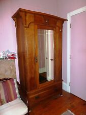 Solid oak, two section armoire; beveled mirror.