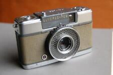 Olympus Pen EE half frame camera.