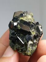 Chromium rich epidote crystals on matrix with nice formation and luster from Pak