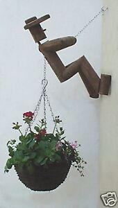 Designer wooden man hanging basket holder / bracket