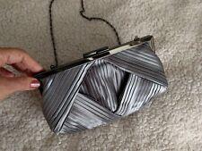 Olga Berg silver satin womans evening bag