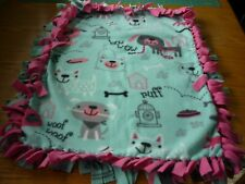 Handmade fleece tie blanket of sketched puppies for a small pet
