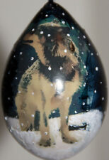 gourd Christmas ornament with wolf in the snow