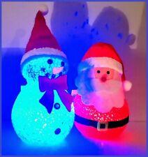A PAIR OF COLOUR CHANGING LIGHT UP SNOWMAN & SANTA CLAUS