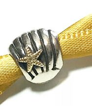 GENUINE PANDORA SHELL CHARM WITH 14 CARAT GOLD STAR VERY RARE RETIRED.