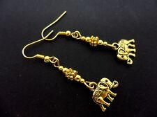 A PAIR OF  GOLD COLOUR DANGLY ELEPHANT  EARRINGS. NEW.