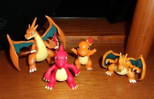 """4 different Pokémon Charizard 3"""" Articulated Figures Tomy Nintendo new condition"""