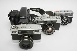 lot of 4x old cameras. Including Minolta and Fujica rangefinders. As found