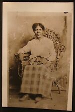 Antique Photo Black Woman Middle Aged Flowers on Lap Wicker Chair