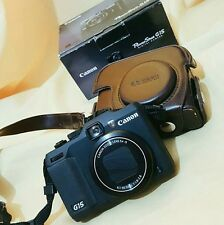 Canon G15 (with leather case)