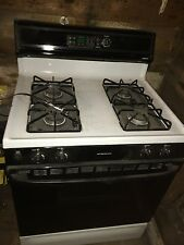 A Hotpoint Gas Stove white and black self cleaning oven