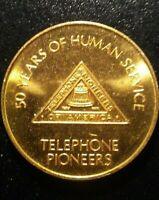 TELEPHONE PIONEERS OF AMERICA 50 YEARS OF HUMAN SERVICE TOKEN!    BB800UDC