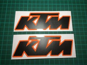 (X2) KTM Logo Decals Stickers 130x45mm MATTE BLACK / GLOSS ORANGE BACKGROUND