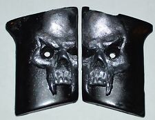 Phoenix Arms Raven 25 ACP slide safety pistol grips pearl skull on black plastic