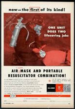 1957 Globe fire resuscitator air oxygen mask fireman photo vintage print ad