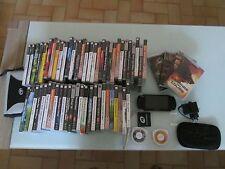 lot psp 3004 + 56 jeux + 5 films + 2 sacoches superbe etat