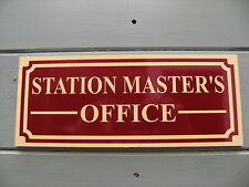 A Shed, workshop, train room,sign 'STATION MASTER'S OFFICE'. reversed cut r/cus